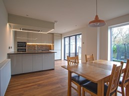 Open plan kitchen/diner with bifold doors & full height glazing